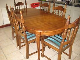 Dark Brown Table 7ft x 3ft and 7 Solid Wood Chairs for Sale