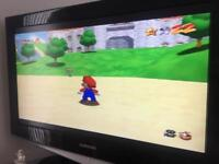 Old console Nintendo 64 console and games,4 controllers
