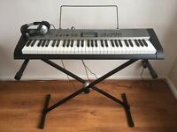 Casio CTK-1300 Keyboard with adjustable stand and Numark Headphones- perfect condition