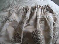 Pair of Beige patterned curtains with tiebacks and pelmet