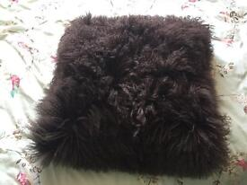 Large fluffy cushion