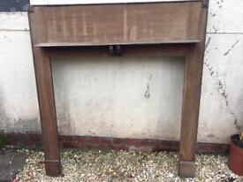 Old wooden fire surround and mantelpiece