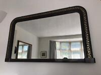 Large antique dark wood wall mirror with gold detailing