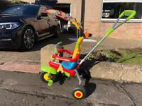 Push along tricycle with control bar and shade
