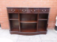A Dark Wood Serpentine Bookcase/Sideboard