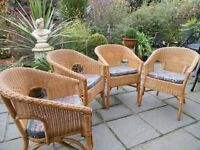 4 Ikea Rattan chairs with seat pads.