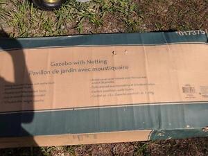New in box 8' x 8' gazebo with netting