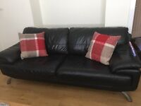 Harvey's 2x black leather sofas one three seater one two seater chrome effect legs.