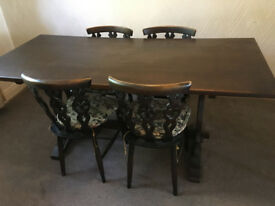 Jacobean style dark wood dining table