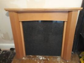 Beech effect fire surround with faux black marble back panel good condition