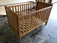 Oak cotbed with green sheep mattress