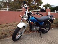 Blue suzuki 125cc vanvan