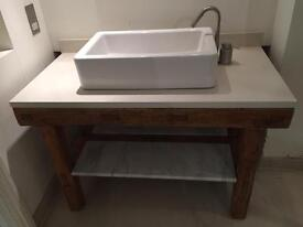 Table with wash basin and water tap