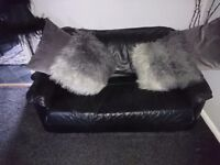Black leather two seater sofa and leather reclining chair