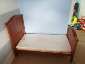 Solid toddler bed with matching wardrobe. Mattress still in wrapping