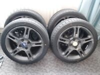 FORD FIESTA FIVE SPOKE ALLOY WHEELS WITH VERY GOOD TYRES.