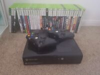 Xbox 360 with 92 pre installed games and 34 disc games !!!