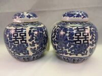 2 blue and white oriental ginger jars