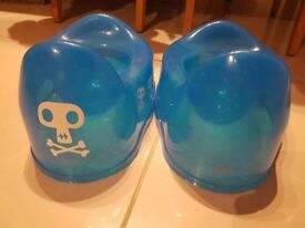 2 Blue boys Tippitoes potties – one plain blue and one with skull and crossbones vinyl motifs on it