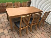 Solid dining table with 6 leather chairs