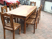 Dining tabel and 8 matching chairs foe sale. Looks a bit like rosewood.