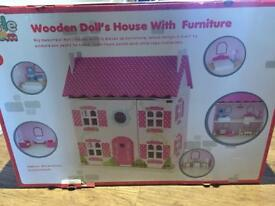 Brand new unopened dolls house with furniture