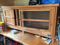 Wooden hutch with separate sleeping compartment