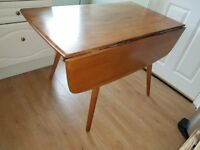 Ercol Elm dining table and four Ercol Windsor dining Chairs