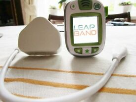 Green Leapfrog Leapband activity tracker, USB connector and adapter plug