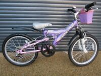 GIRLS OPTIMA PANASHE SUSPENSION BIKE IN VERY GOOD USED CONDITION.. (SUIT APPROX. AGE. 6 / 7+)..