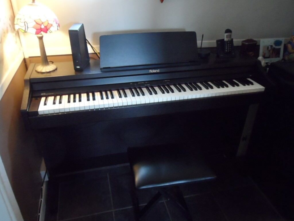 digital piano roland RP301 well looked after in showroom condition.