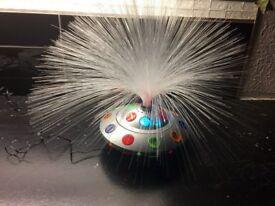 Fibre optic revolving lamp
