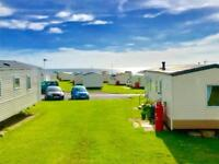 Cheap 6 berth caravan for sale with a sea view & 2018 fees included! NE63 9YD