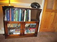 BOOK CASE WITH TWO SHELVES AND FULL WIDTH STORAGE UNDERNEATH WITH GLASS DOORS