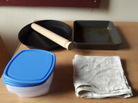Pie tin and baking tin , containers, rolling pin and tea towel