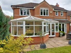 CONSERVATORY WITH ELECTRIC OPENERS, WELL MADE
