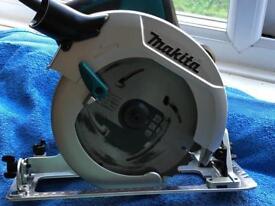 Makita HS7601J 240v Skill Saw. New with 2 New blades