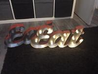 2 light up signs