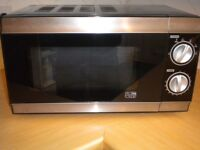 microwave oven in black and silver