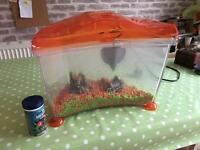 Orange fish tank with pump. Just need a fish. Ready to go tank.