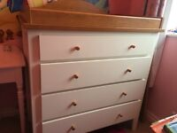 Baby change drawers with matching shelf unit.