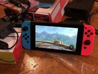 Nintendo Switch with Digital Zelda and Physical Mario Kart