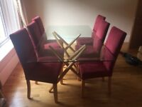 Glass dining table and six chairs Vgc
