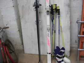 set of skis and poles and boots for sale