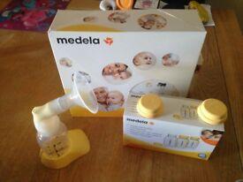 Medela electric breast pump & extra bottles