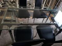 Glass Extendable Dining table, only 5 black faux leather chairs