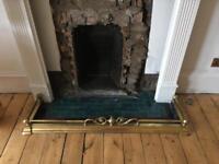 Ornate brass fireplace border