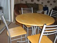 Circular wipe clean table and 4 chairs. Few scratches on table/chairs Very solid,sturdy set.