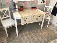 White pine table and 2 chairs brand new unwanted gift!size 2ft 2inches x 3ft 6 inches buyer collects