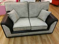 Light grey fabric and faux leather 2 seater sofa